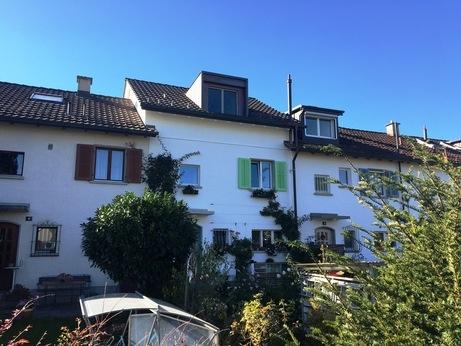 Nach Dachaufstockung Reiheneinfamilienhaus